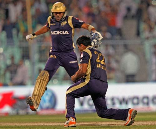 Kolkata Knight Riders bowler Rajat Bhatia (right) celebrates the wicket of Deccan Chargers batsman Bharat Chipili