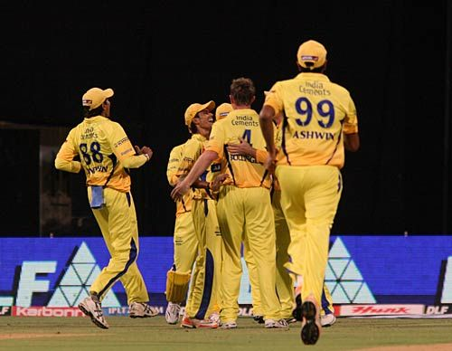 Chennai bowler Doug Bollinger and team-mates celebrate the wicket of Mumbai captain Sachin Tendulkar