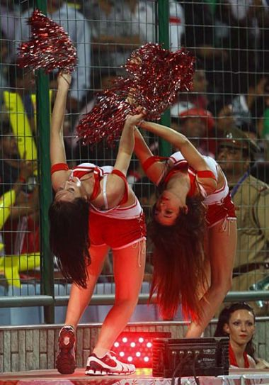 Cheerleaders perform during the Delhi versus Punjab IPL cricket match