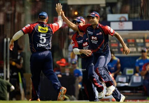 Delhi Daredevils paceman Irfan Pathan (right) celebrates the wicket of Pune Warriors batsman Graeme Smith with teammates