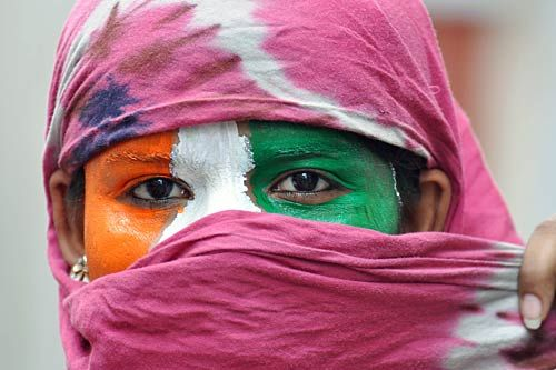 Face painted in tri-colour