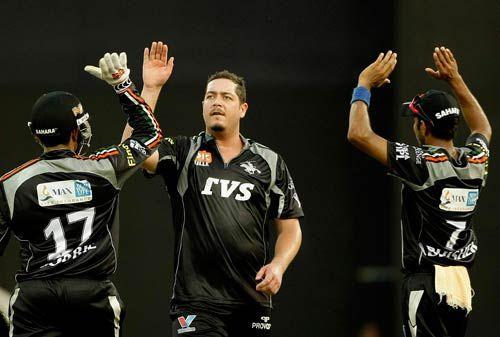 Pune Warriors all-rounder Jesse Ryder (centre) celebrates the wicket of Delhi Daredevils batsman Virender Sehwag