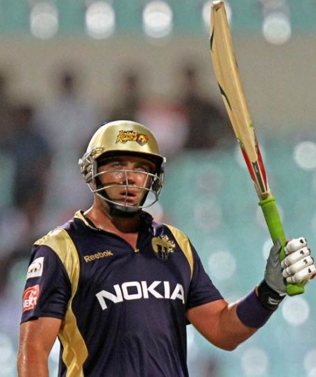 Kolkata Knight Riders batsman Jacques Kallis raises his bat to celebrate this half-century