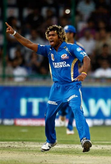 Mumbai Indians' Lasith Malinga celebrates after claiming Morne Morkel's wicket
