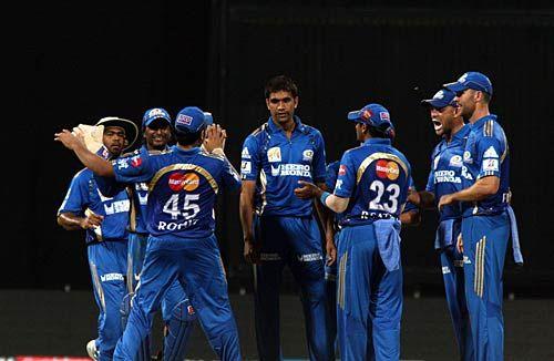 Mumbai paceman Munaf Patel celebrates the wicket of Chennai batsman Murali Vijay