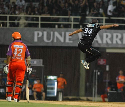 Pune paceman Wayne Parnell celebrates the wicket of Kochi batsman Parthiv Patel
