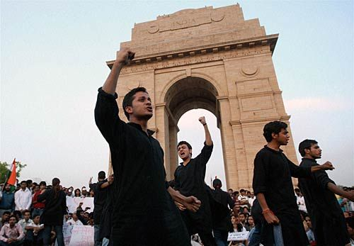Activists stage a street play at India Gate.