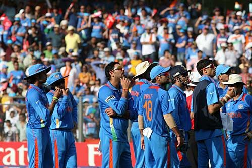 Indian players waits for third umpire's decision