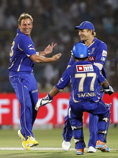 Rajasthan captain Shane Warne celebrates the dismissal of Kochi batsman Brad Hodge