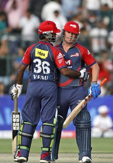Delhi batsman David Warner (left) is congratulated by Venugopal Rao