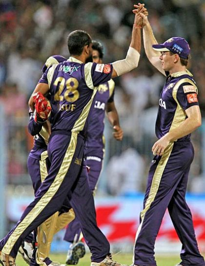 Kolkata bowler Yusuf Pathan celebrates the wicket of Paul Valthaty with team-mates
