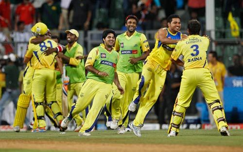 Chennai team run to greet team-mate Suresh Raina (right) after their win over Bangalore