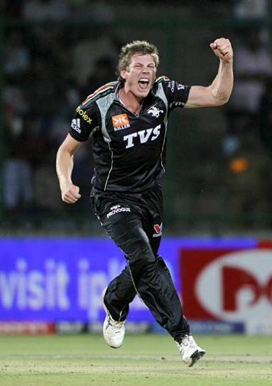 Pune paceman James Faulkner celebrates after claiming the wicket of Delhi opener David Warner