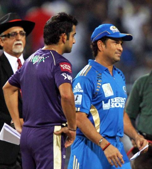 Mumbai captain Sachin Tendulkar and his Kolkata counterpart Gautam Gambhir get ready for the toss
