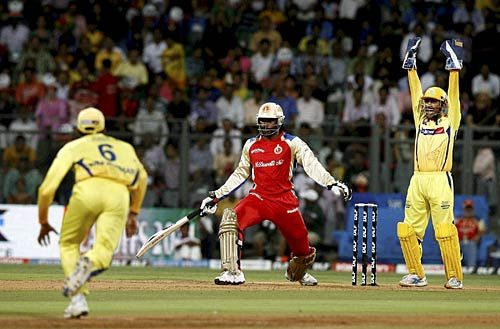 Chennai captain Mahendra Singh Dhoni successfully appeals for an LBW decision against Bangalore opener Chris Gayle