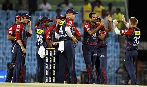 Delhi paceman Irfan Pathan and team-mates celebrate the wicket of Chennai opener Michael Hussey
