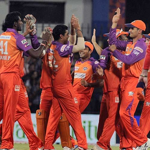 Kochi players celebrate a Rajasthan wicket