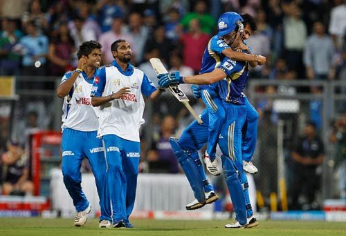 A Mumbai plays jumps to hug team-mate James Franklin after their in win over Kolkata during the IPL eliminator