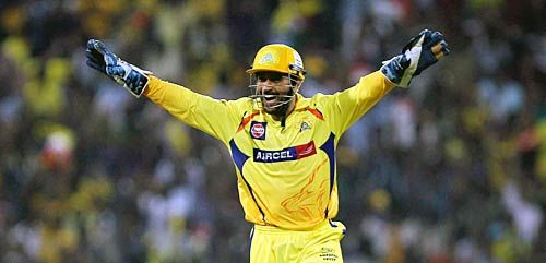 Chennai skipper M.S. Dhoni celebrates the wicket of Delhi batsman Colin Ingram