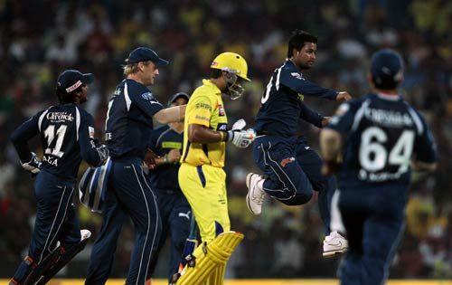 Chennai opener Murali Vijay walks back as Hyderabad's Pragyan Ojha celebrates