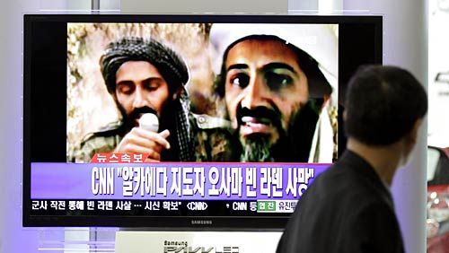A man in Seoul watches a TV broadcast of Osama bin Laden's death