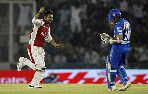 Punjab medium-pacer Praveen Kumar celebrates the wicket of Mumbai captain and opener Sachin Tendulkar