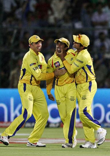 Chennai fielder Wriddhiman Saha (centre) celebrates with team-mates Mike Hussey and Suresh Raina after catching the ball off Rajasthan batsman Ross Taylor