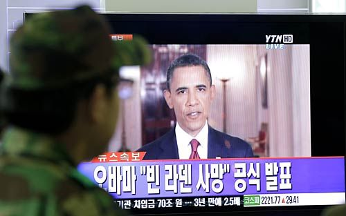 A South Korean soldier watches a TV broadcast of US President Barack Obama announcing the death of Osama bin Laden