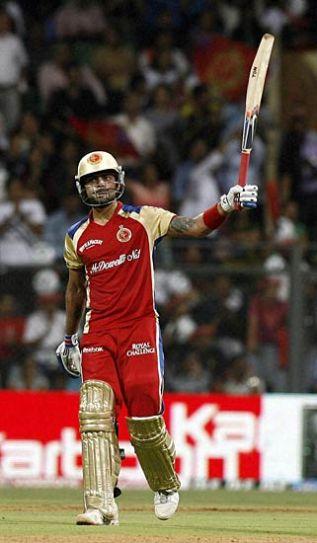 Bangalore batsman Virat Kohli celebrates his half-century