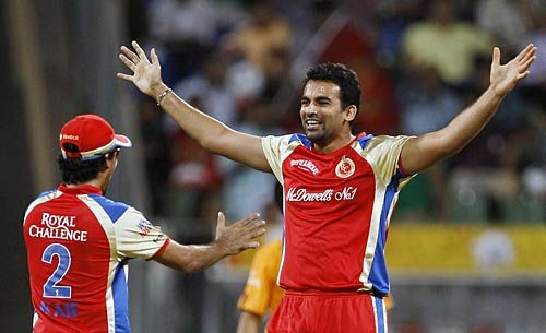 Bangalore paceman Zaheer Khan celebrates the wicket of Chennai opener Michael Hussey