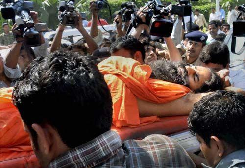 Baba Ramdev being taken to hospital