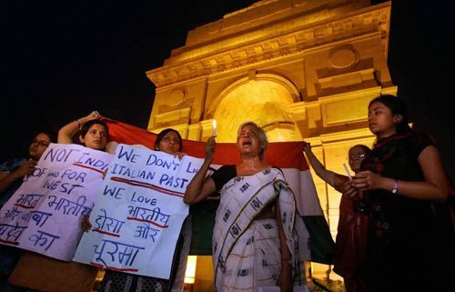 Activists raise slogans during a candle light protest