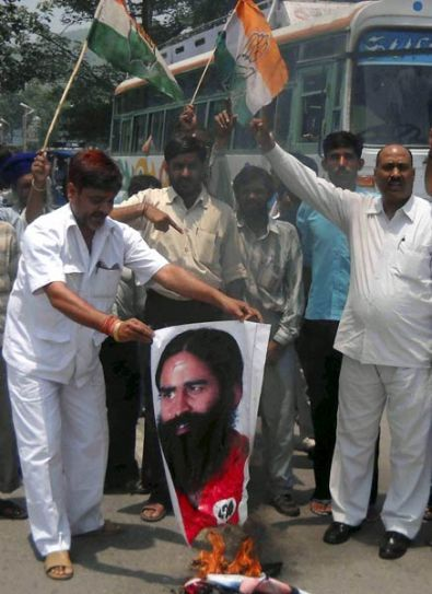Congress activists burn Baba Ramdev posters