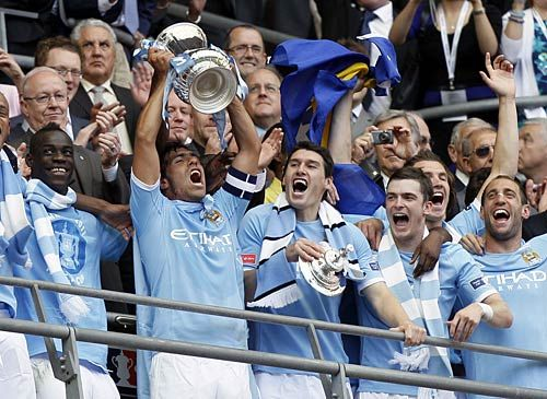 Manchester City striker Carlos Tevez and his team-mates after their FA Cup win