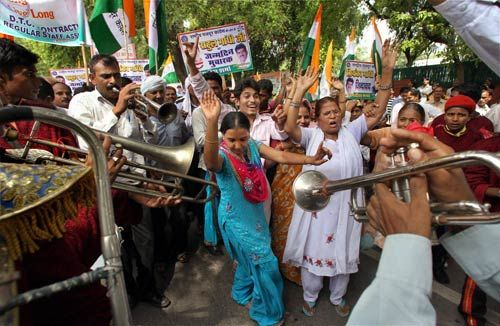 Congress workers outside AICC headquarters in Delhi