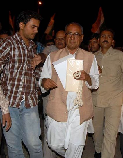 Congress workers and supporters surround Digvijay Singh in Bhopal.