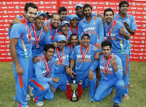 India players pose with the trophy
