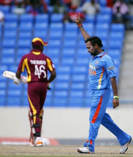 India spinner Amit Mishra celebrates the wicket of West Indies batsman Darren Bravo