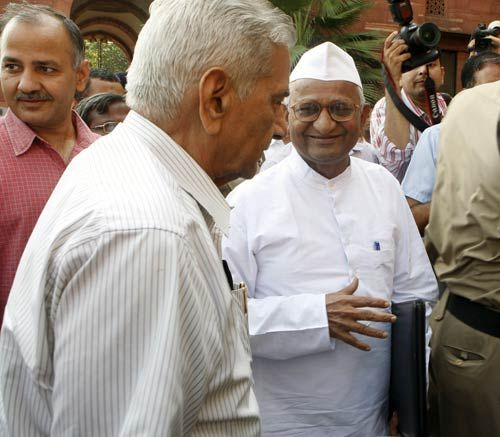 Civil society members Anna Hazare and Shanti Bhushan arrive to attend Lokpal meet in Delhi.