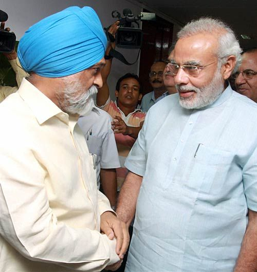Montek Singh Ahluwalia and Narendra Modi