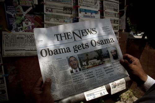 A man reading news of Osama's death