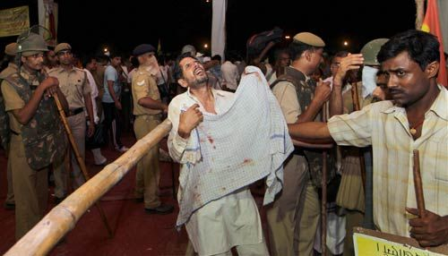 Police evict supporters of Baba Ramdev