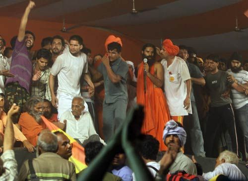 Baba Ramdev with his supporters after clash with police