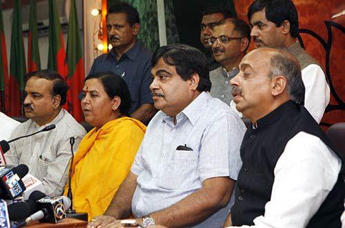 Former BJP leader Uma Bharti,BJP president Nitin Gadkari and Vijay Goel at his residence in Delhi.