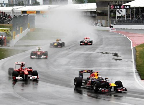 Red Bull's Sebastian Vettel leads Ferrari's Fernando Alonso and Felipe Massa