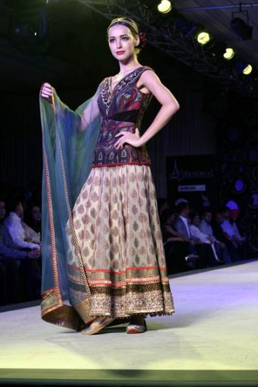A model walks the ramp on Day 1 of Delhi Couture Week