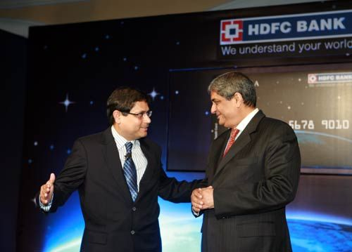 Pralay Mondal (left), Country Head, Retail Assets and Credit Cards, HDFC Bank, and Aditya Puri, Managing Director, HDFC Bank during the launch of INFINIA credit card in Mumbai
