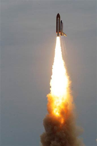 Space shuttle Atlantis lifts off from the Kennedy Space Center