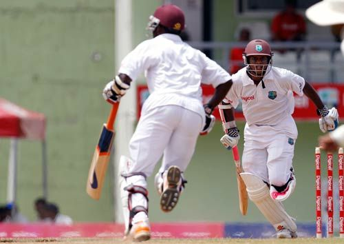 West Indies' Shivnarine Chanderpaul (right) and Fidel Edwards
