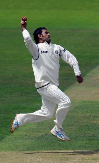 India captain Mahendra Singh Dhoni bowls
